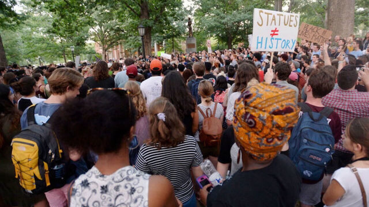 Arrests made as protests converge over toppled Confederate statue