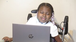 Kennedy_Ross_at_her_computer.JPG
