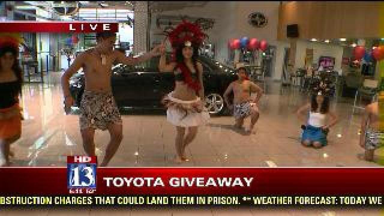 Dance performance before car giveaway