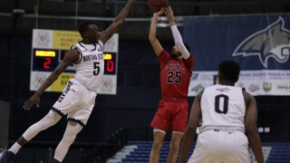 Amin Adamu contests Michael Meadow's 3-pointer