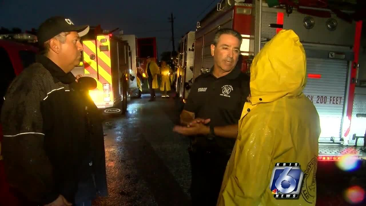City first responders work at the Las Colonias area after a recent flood
