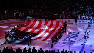 Father returns from active duty to surprise son during hockey game
