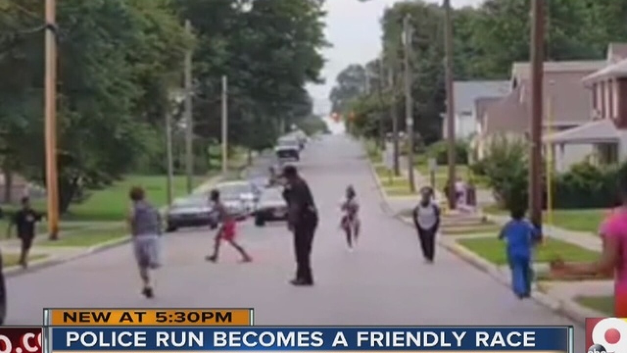 Watch: Cop calms tensions with relay race, Icees