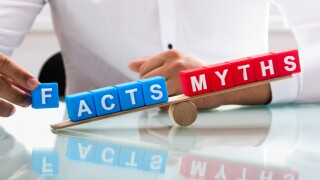 Businessman showing unbalance between facts and myths