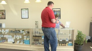 One of many shoppers learns about the several CBD products offered at Gold Nugget.