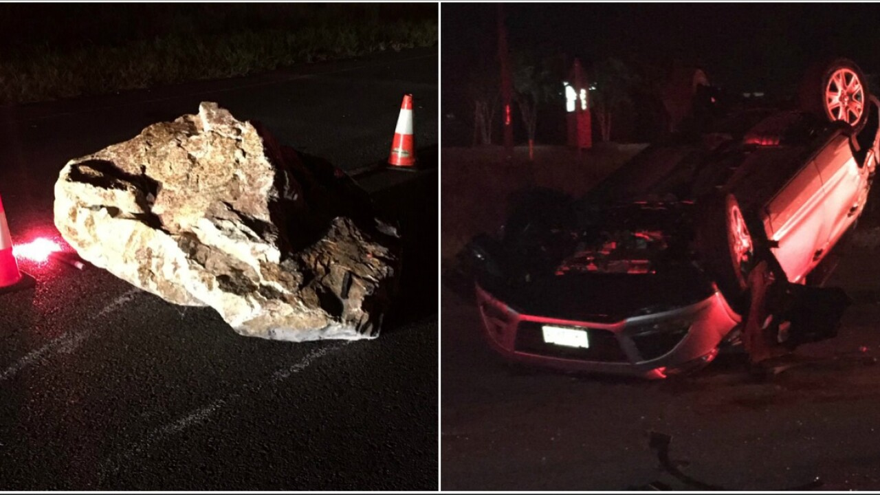 Car flips after hitting picnic table-sized boulder on Friday the 13th