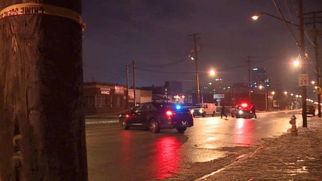 Two men shot at adult club on east side