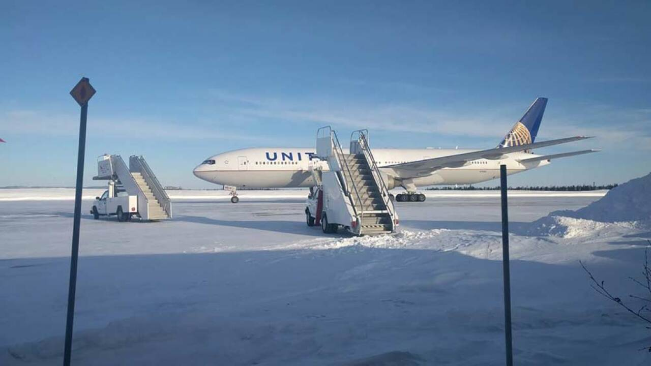 Passengers aboard a United Airlines flight from Newark, New Jersey, to Hong Kong were left stuck on a runway for more than 14 hours in frigid weather with a dwindling supply of food.