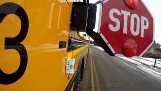 Over a hundred drivers blow by stopped school buses in one Montana district. Why are they getting away with it?