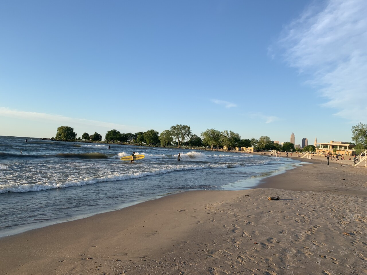 Surfers catch waves at Cleveland's Edgewater Beach.