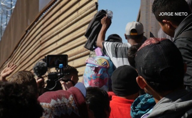 Clashes erupt as migrant caravan reaches the U.S.-Mexico border