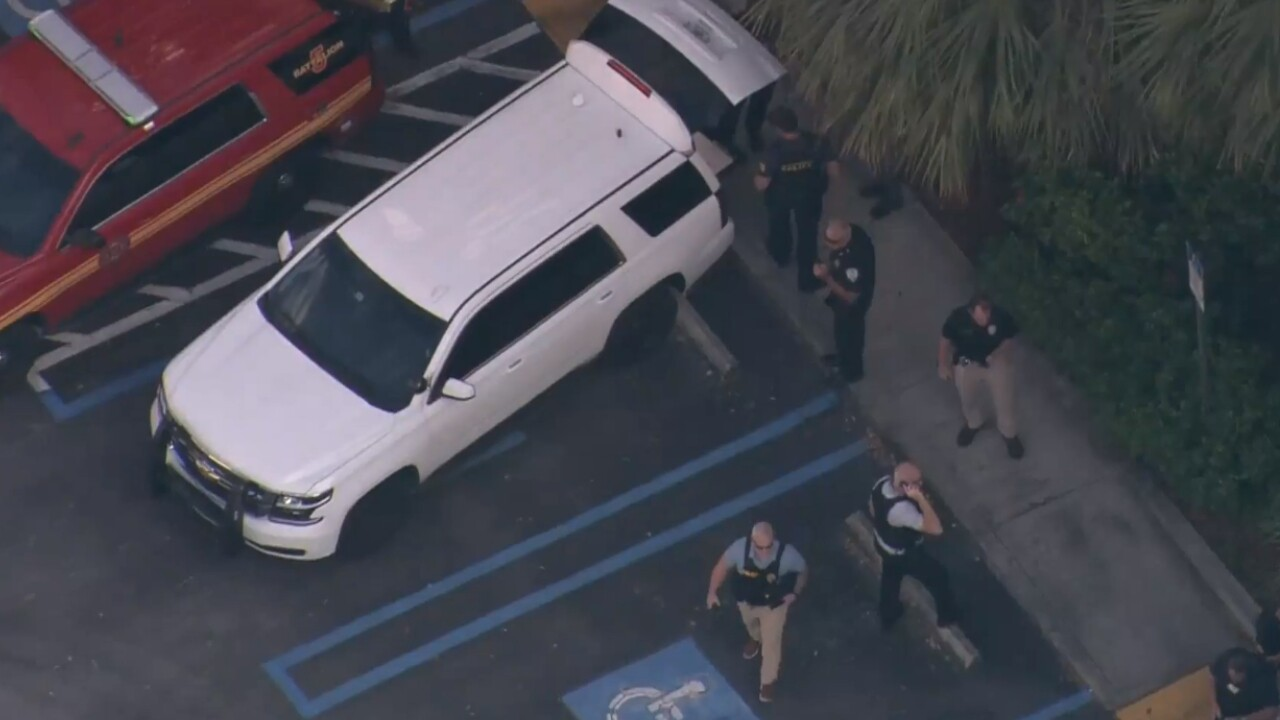 Chopper 5 above police gathered outside Red Roof Inn after shots fire