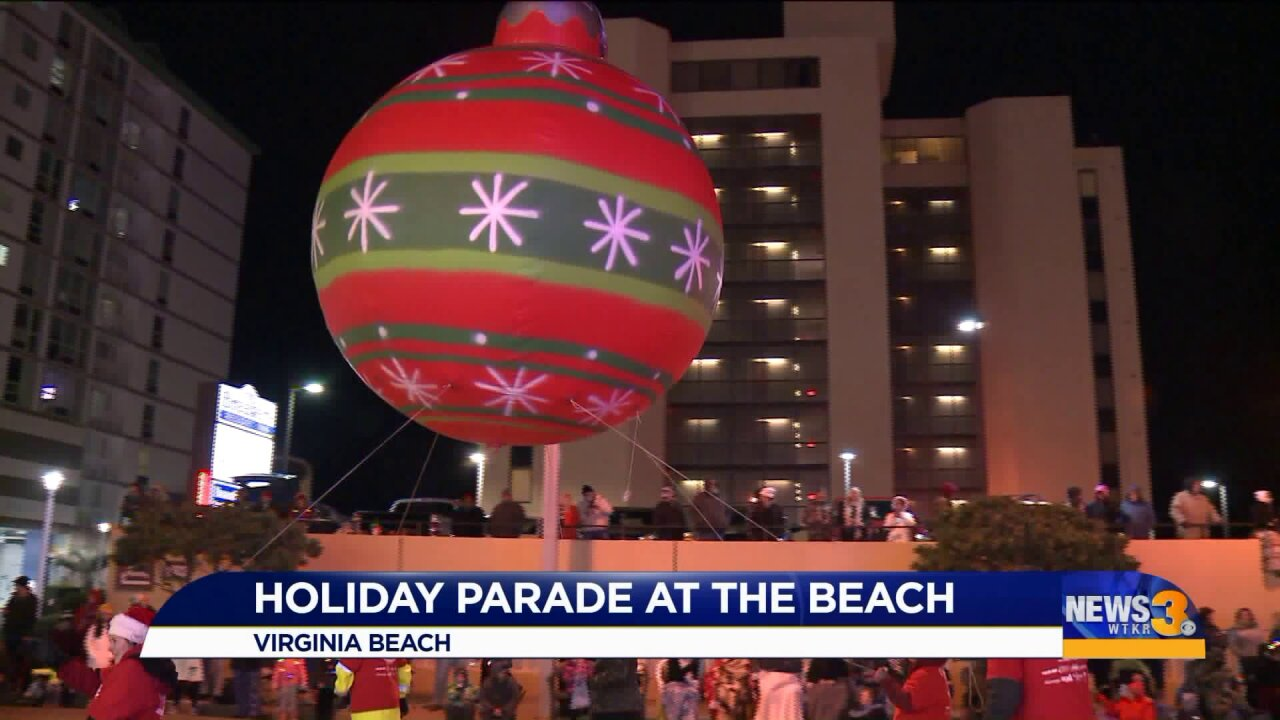 Christmas lights and sounds flood streets for annual Holiday Parade