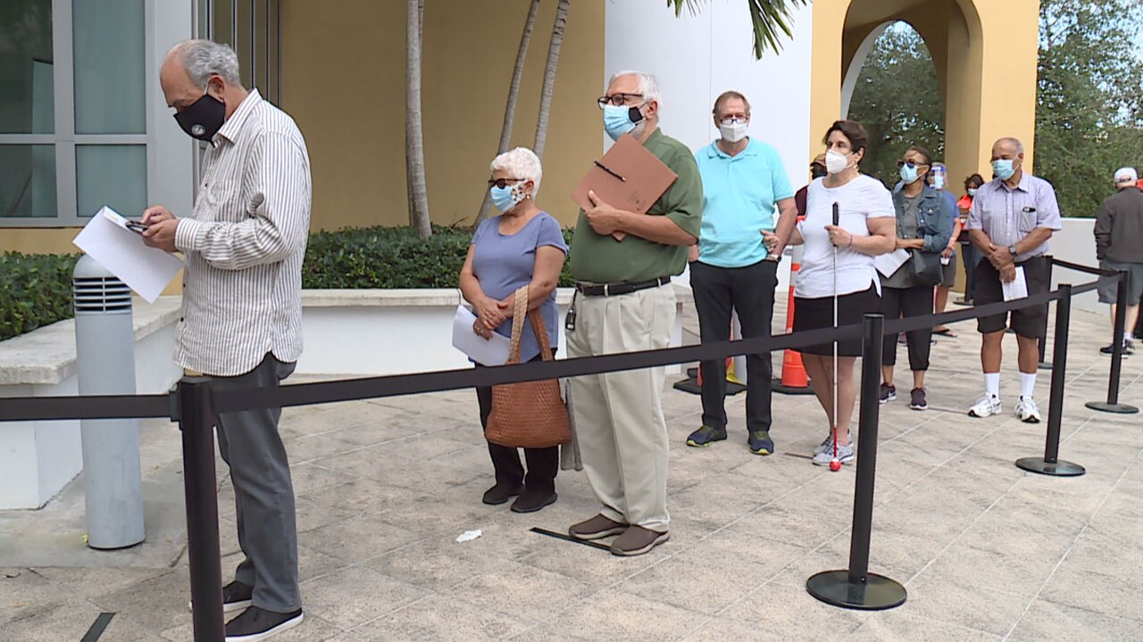 Seniors wait in line for COVID-19 vaccine in West Palm Beach