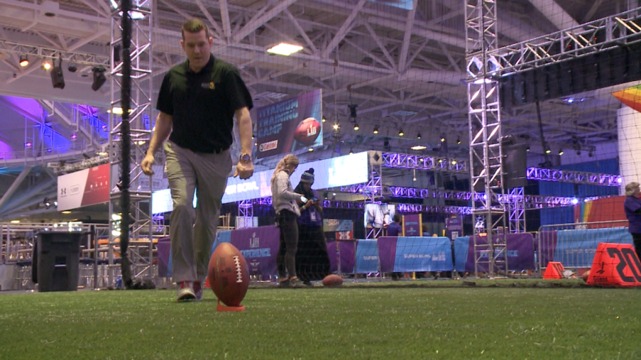 Wink kicks, throws, runs, jumps and bumps his way through Super Bowl Experience