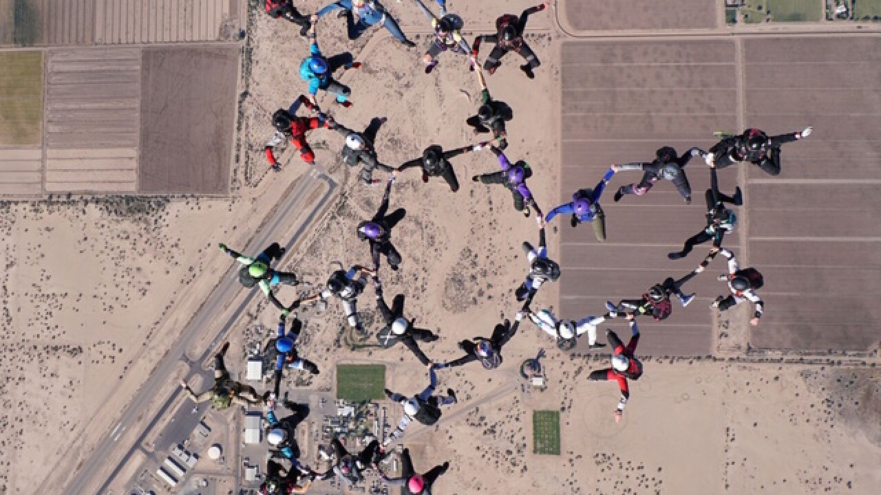 Dozens of women set upright, all-female skydiving record in Eloy