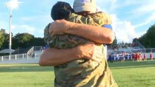 Soldier stationed across seas surprises husband at Delcambre football game