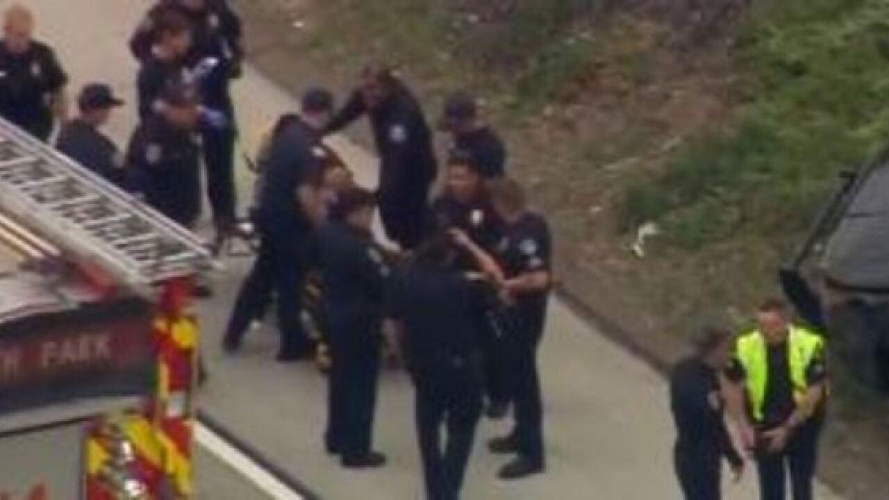 SDPD Officer rolls car on I-15