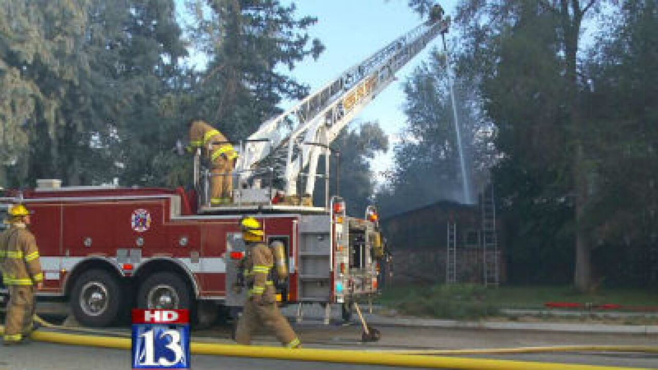 Vacant home destroyed in Roy fire