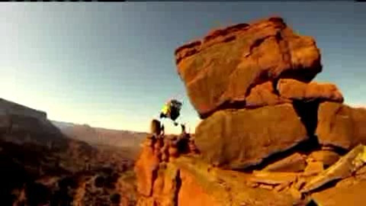 BASE jumper leaps from cliff, lands atop a sandstone tower in Moab