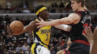 Aaron Holiday, Lauri Markkanen
