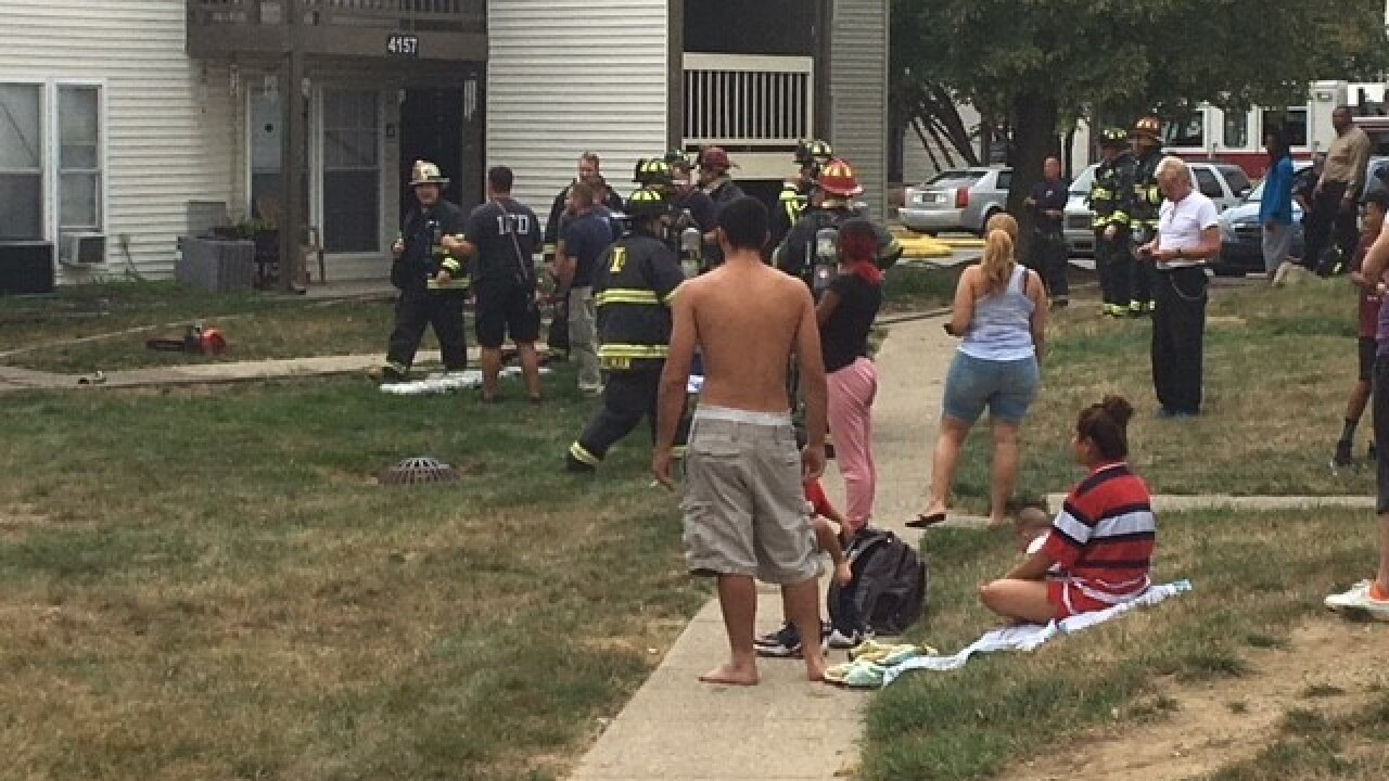 Fire at apartment complex displaces 10 people