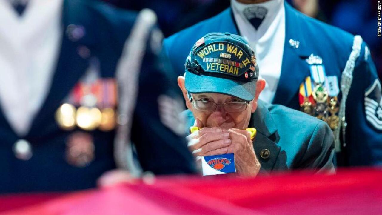 96-year-old WWII veteran wows audience with harmonica rendition of the National Anthem