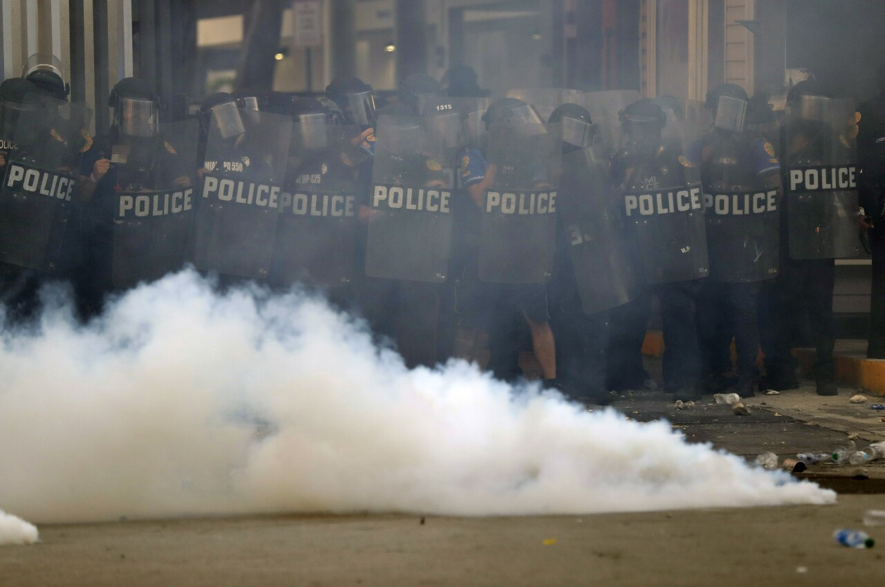Police hold line as tear gas canister thrown back at them, May 30