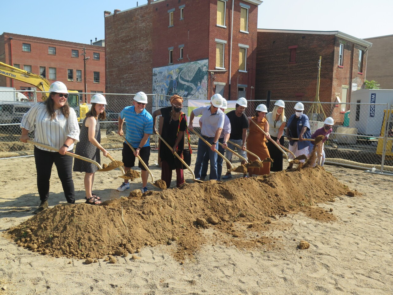 Mary Delaney, far left, and others who have been involved in the LPH Thrives development take a turn shoveling some ceremonial dirt at the project's official groundbreaking on Aug. 26, 2021.