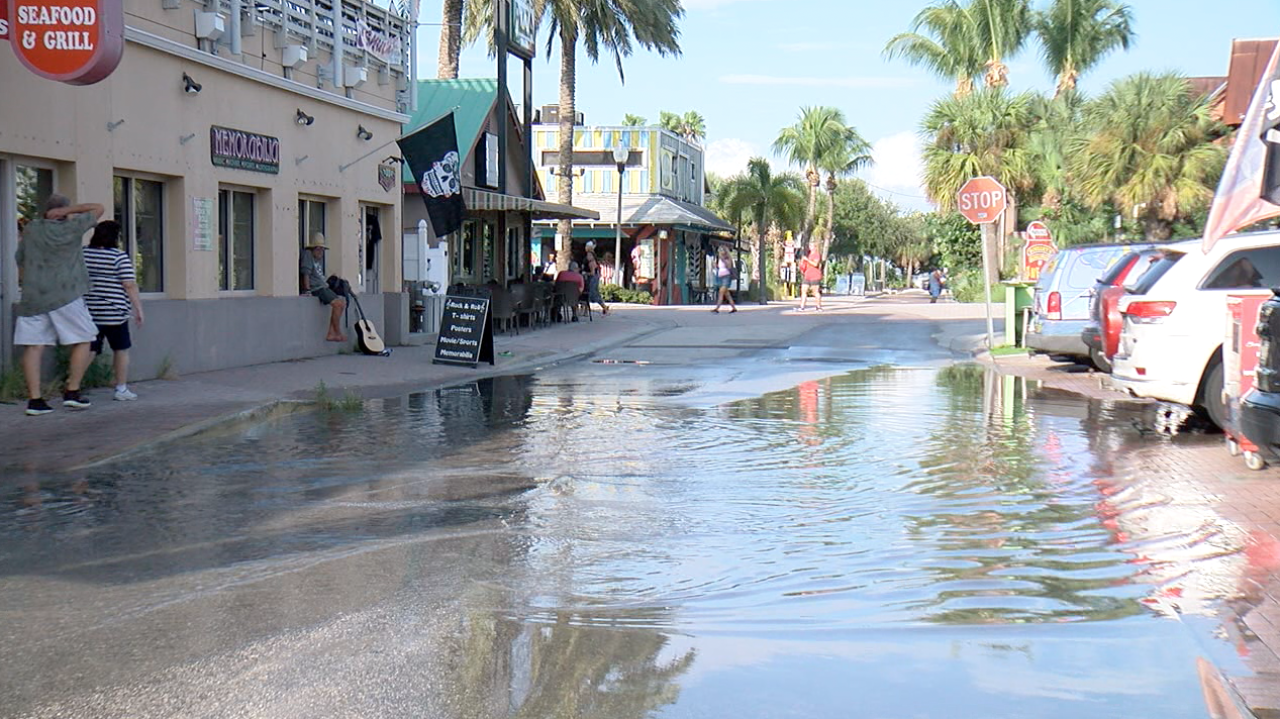 Water backs up in John's Pass Village as a result of blocked storm drains