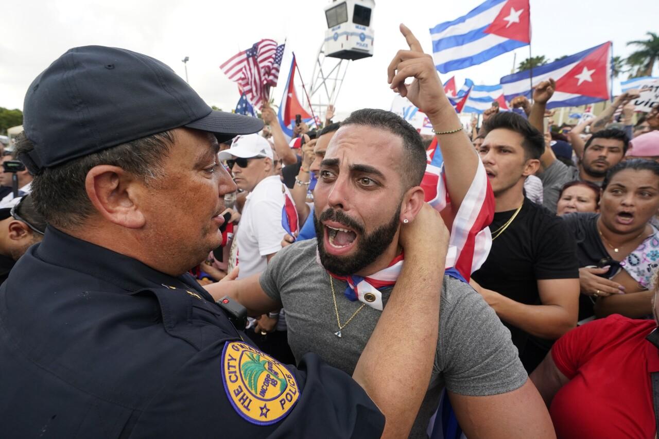 Miami Police Chief Art Acevedo hugs demonstrator in Little Havana, July 14, 2021