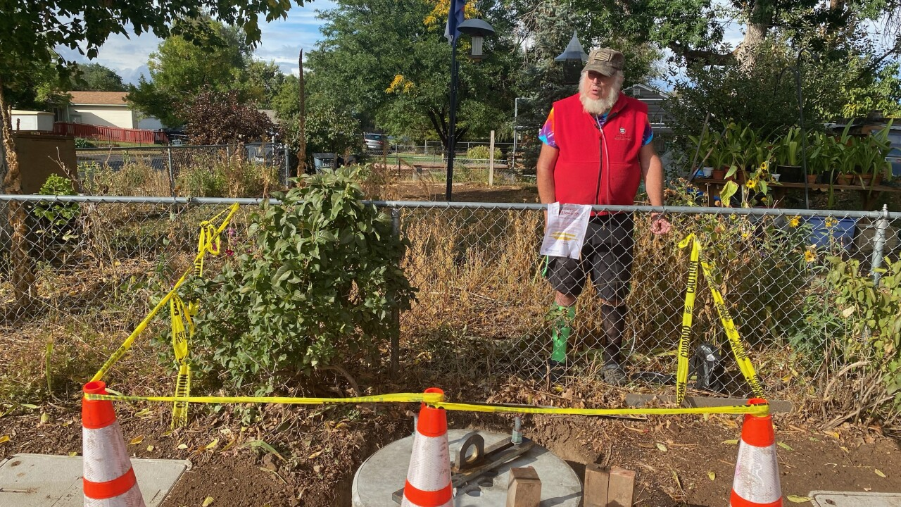 Richard Rice stands at his property line where the base of a 5G tower was set on Monda