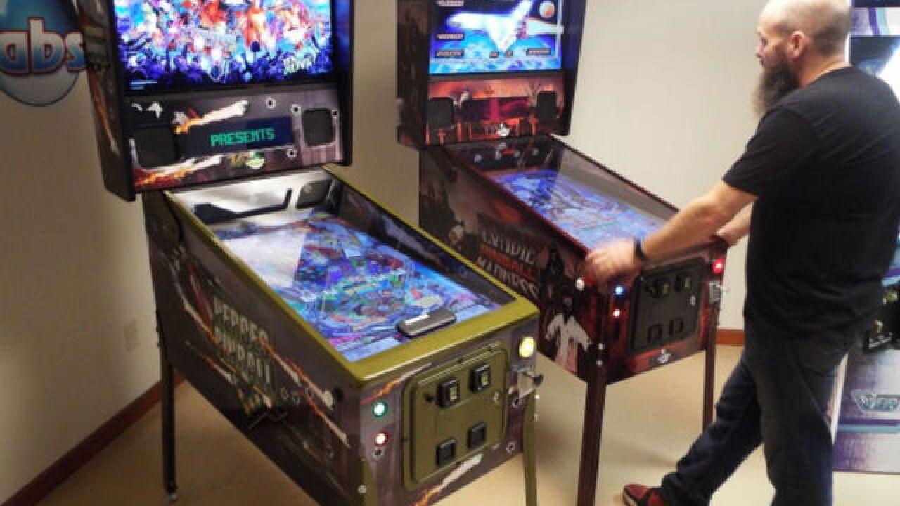 Company puts new tilt on pinball, arcade games