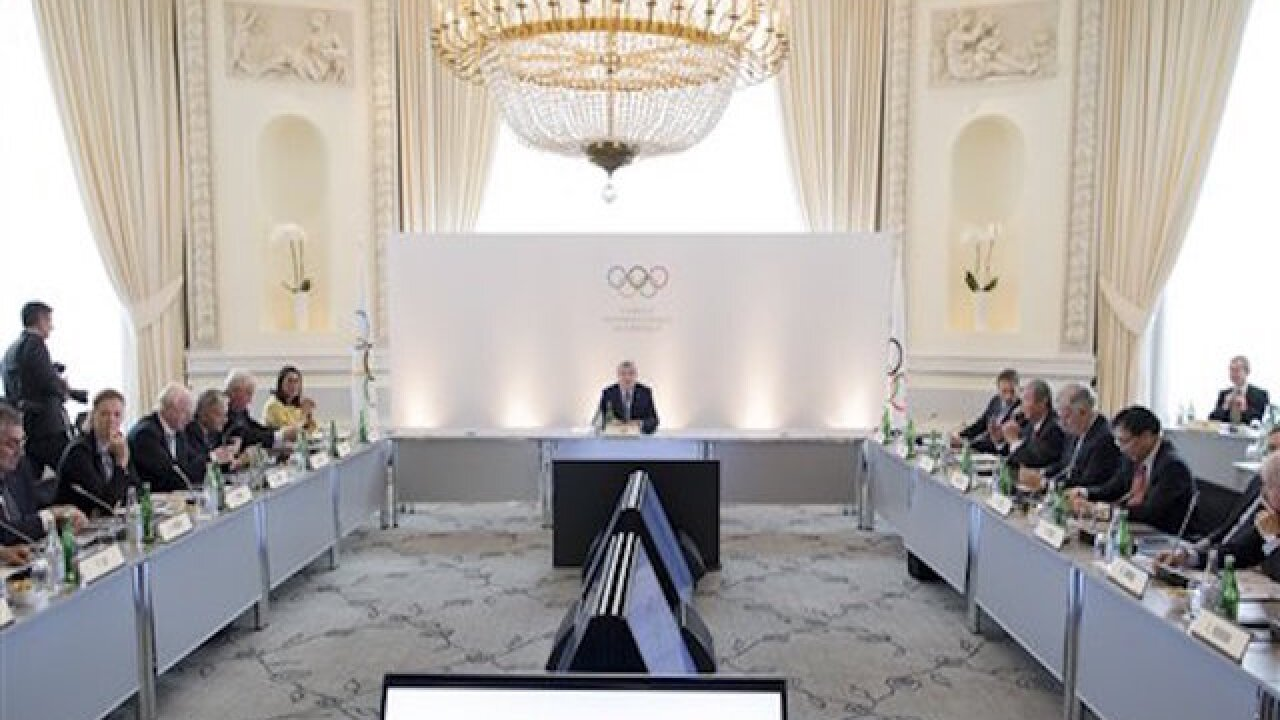 IOC opens door for Russian track at Olympics