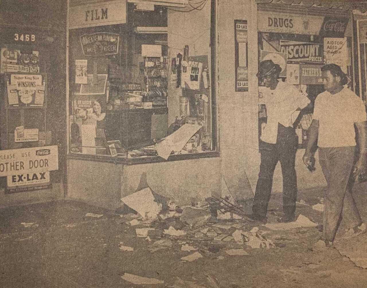 Bob Stigers Men Walking through the destruction in front of Torfs.jpeg