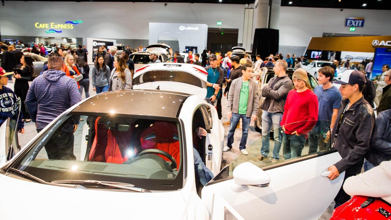 Crowd around car san diego international auto show.jpg