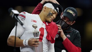 Ohio State Buckeyes QB Justin Fields and head coach Ryan Day after winning College Football Playoff semifinal at Sugar Bowl