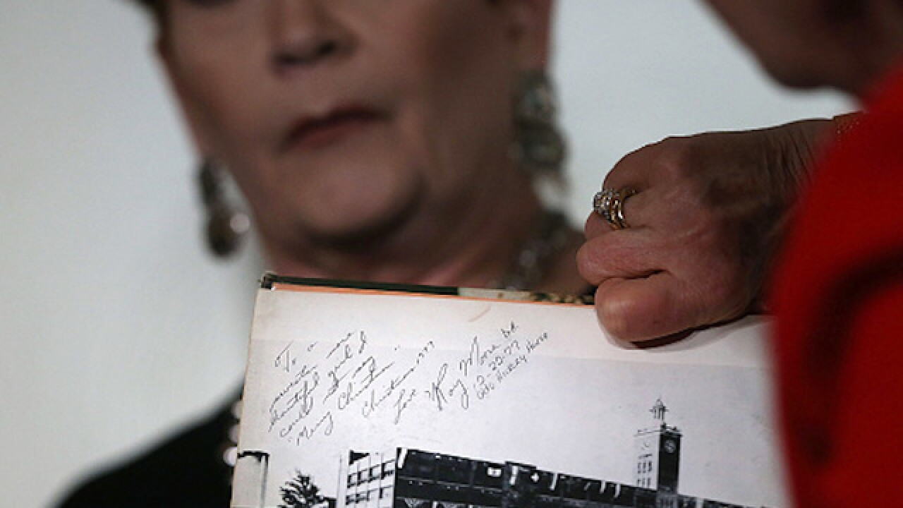 Roy Moore accuser acknowledges she added notes to yearbook signature