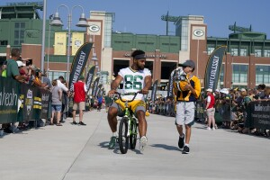 Malik Taylor takes part in riding bikes to practice, a Packers tradition