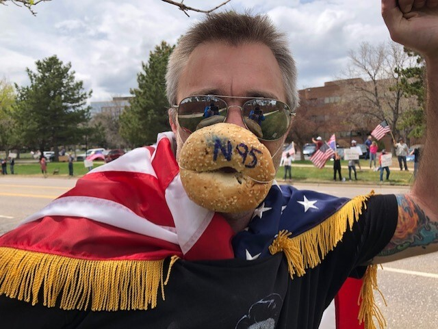 Protester wearing bagel face mask