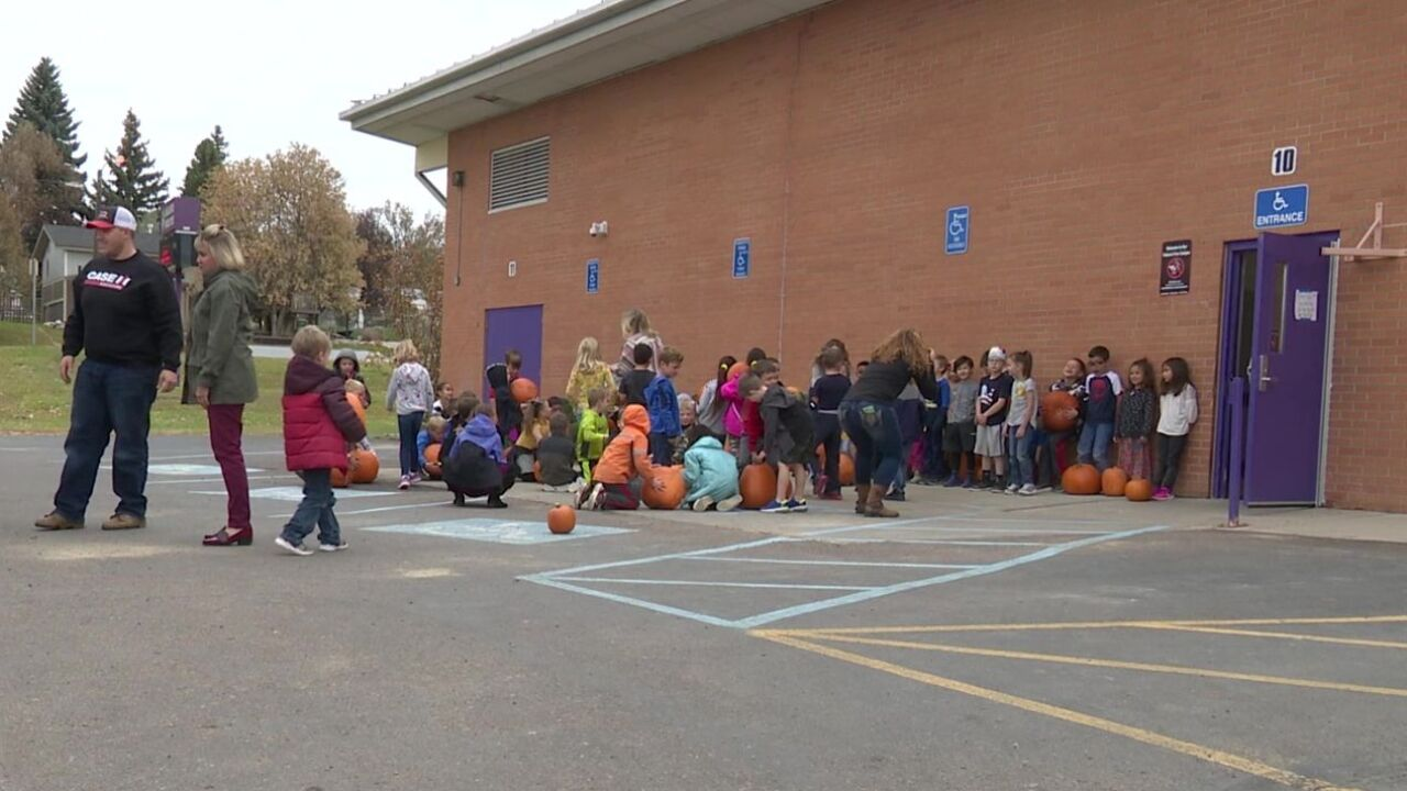 Torgerson's LLC unloaded a trailer-full of festivity, loading up first-graders with free pumpkins.