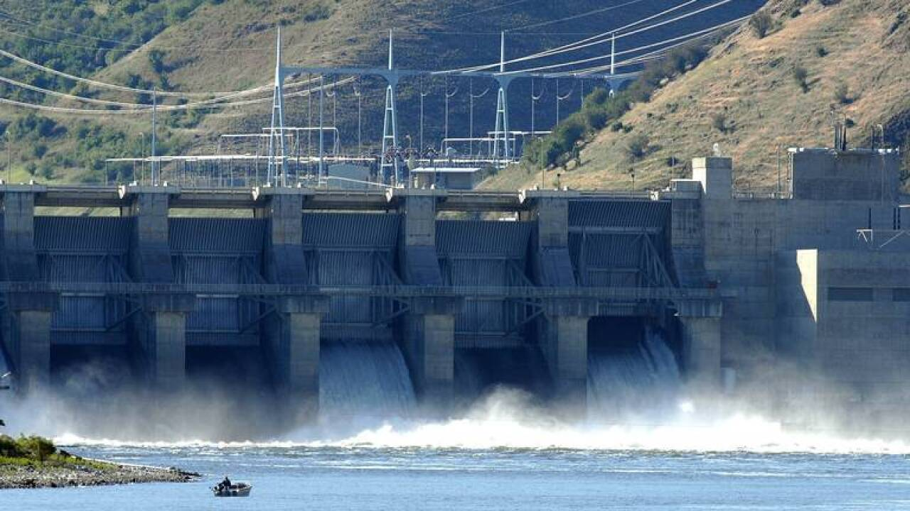 Water spills at Lower Granite Dam, one of the four dams on the lower Snake River salmon advocates have targeted for breaching. A final environmental study does not recommend breaching or removing the dams.