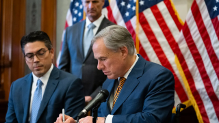 CaptureGov. Greg Abbott signs Senate Bill 2 and Senate Bill 3 at the Texas Capitol on Tues, Jun. 8, 2022. The omnibus power grid bills will change the state's power grid and the people who oversee it..PNG
