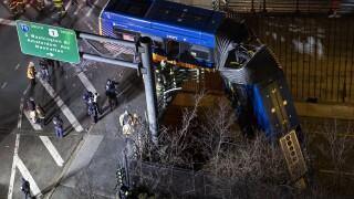 APTOPIX Bus Crash Overpass