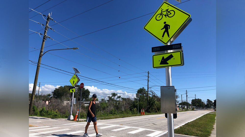 Flashing-crosswalk-installed-at-site-of-fatal-Duke-Energy-Trail-bicycle-crash-1.jpg