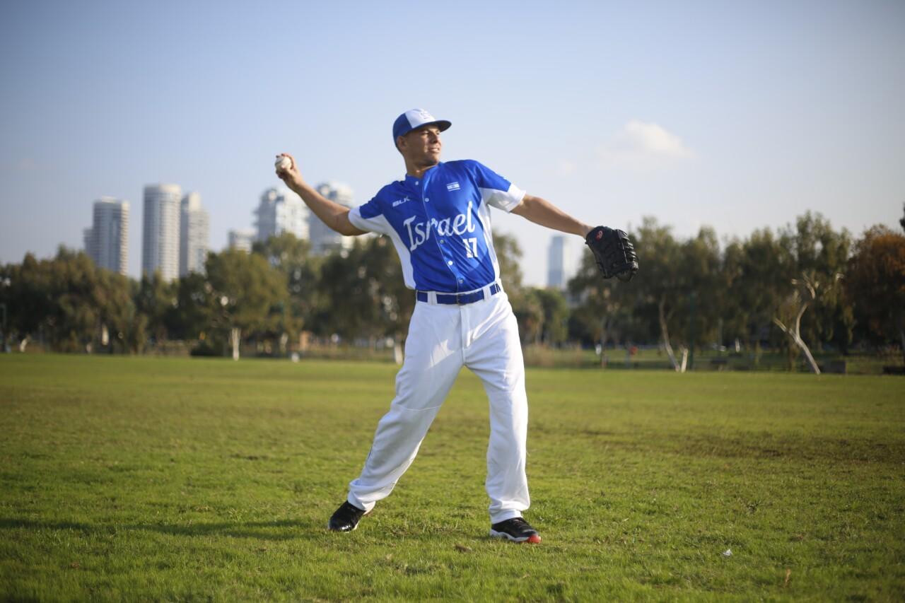 Danny Valencia throws baseball during Israel Olympic team practice, Jan. 14, 2020