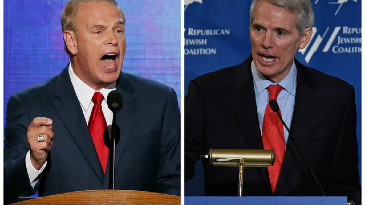 Rob Portman, Ted Strickland spar over their parties' presidential nominees