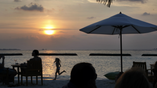 Maldives tourist sunset