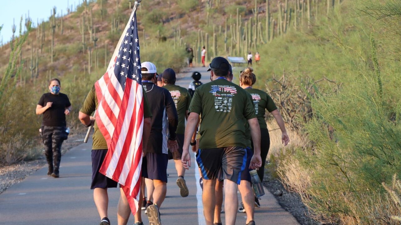 """Members of the Tucson Fire Department climbed Tumamoc Hill this year as a modified """"tower challenge"""" due to COVID-19."""