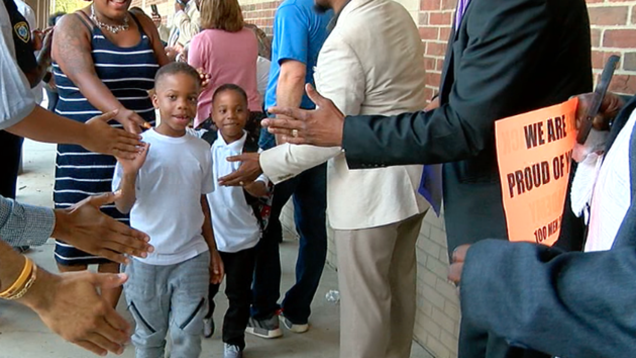 Men suit up to inspire West End, Avondale kids